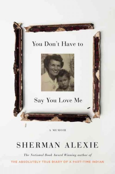 photograph of young Alexie and his mother in black and white surrounded by beat up broken up pieces of picture frame--book cover image