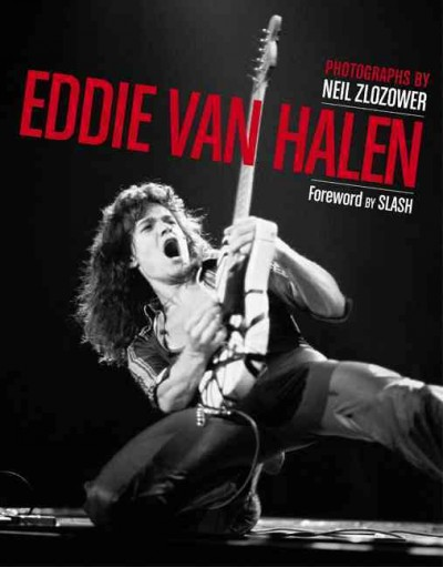 Black and white photograph of young Eddie Van Halen down on one knee, playing guitar, long hair, leather pants--book cover