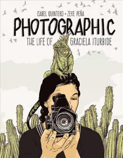 Image of woman with camera facing viewer, cactus behind her and iguana on her head-book cover