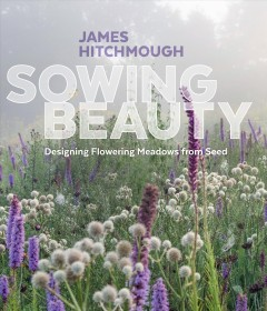 "Book cover with image of flowers in a field on a foggy day. Text reads ""Sowing Beauty - Designing Flowering Meadows from Seed by James Hitchmough"